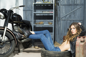 Fototapeta na wymiar Tempting girl in garage