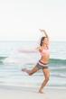 Beautiful woman jumping beside the sea