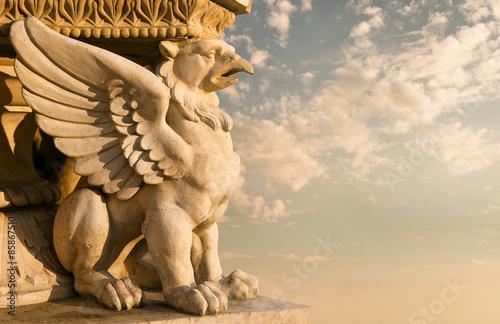 Obraz na płótnie Stone sculpture of a gargoyle at the sunset