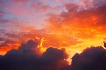 cloudscape at sunset with red clouds