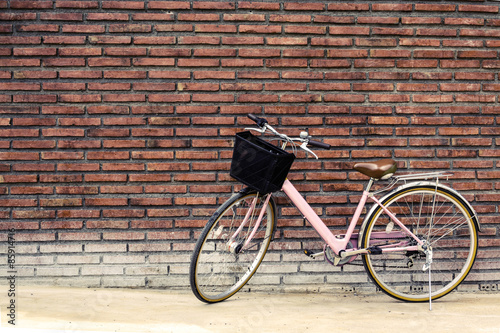Vintage bicycle with old brick wall