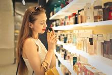 Classy Woman Choosing A Perfum...