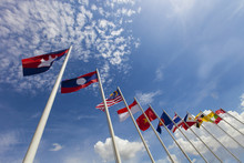 ASEAN Flag And National Flags Of Southeast Asia Countries On Beautiful Blue Sky Background