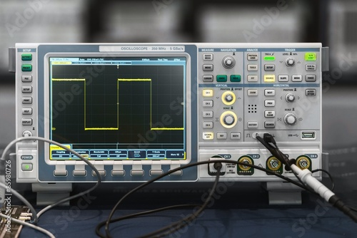 Fotografie, Obraz  Compact industrial oscilloscope on desk