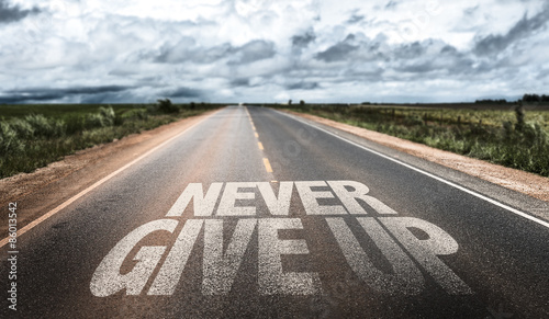 Tablou Canvas Never Give Up written on rural road