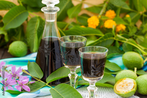 Fotografie, Obraz  Liqueur from young green walnuts, remedy for stomach ache