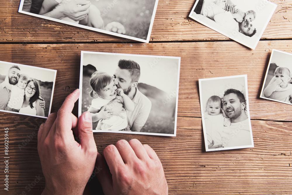 Fototapety, obrazy: Photos on a table
