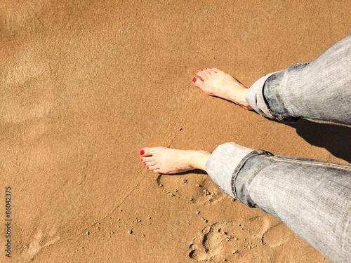 Obraz na plátně Stopy na plaży