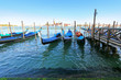 Gondolas at their moorings in the evening in Canale di San Marco, Venice, Italy. San Giorgio Maggiore can be seen on the background.