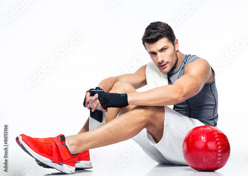 Fitness man resting on the floor Canvas-taulu