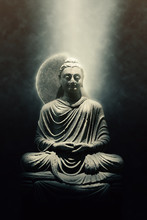Statue Of A Seated Buddha Lit By A Beam Of Light