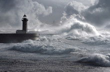 Storm Waves Over The Lighthous...