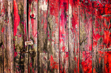 Close Up Of An Antique Wooden Door Painted In Red