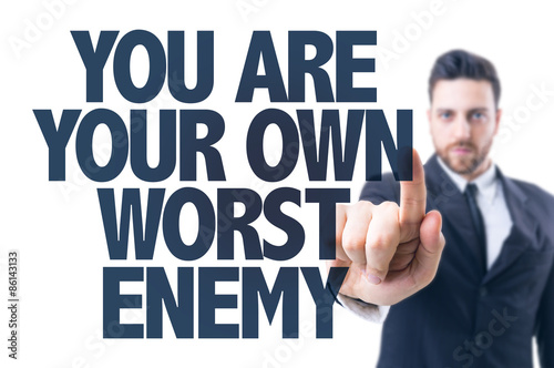Fotografía  Business man pointing the text: You Are Your Own Worst Enemy