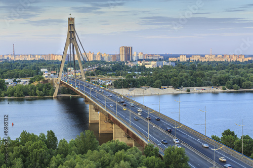 Bridge over Dnipro River in Kyiv city at sunset