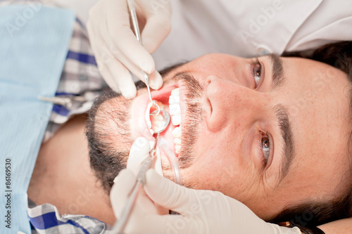 young happy man and woman in a dental examination at dentist Plakat