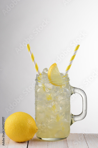 Lemonade Glass With Yellow Straws Canvas Print
