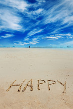 Sign Of Happy Caption Written On Golden Sand At Blue Summer Sky