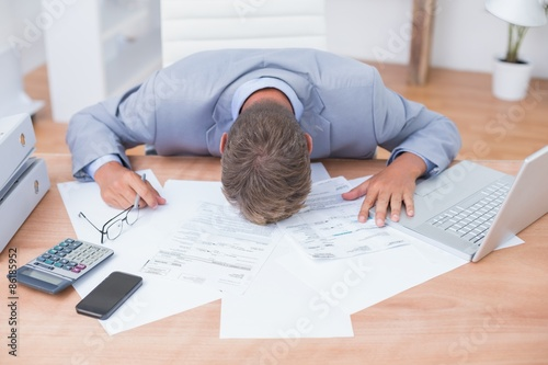Businessman being depressed by accounting Canvas Print