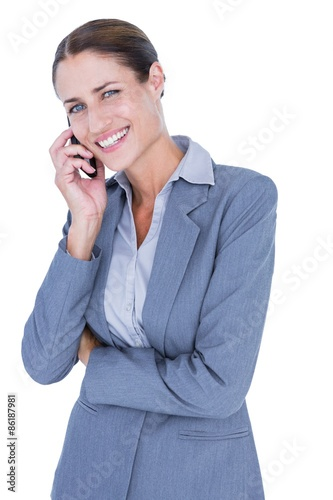 Businesswoman calling with her smartphone Poster