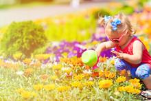 Little Girl Watering Flowers In Summer