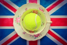 British Tennis - A Cup And Saucer With A Tennis Ball Inside On Top Of A Union Jack Flag