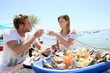 canvas print picture - Couple in seafood restaurant tasting fresh oysters