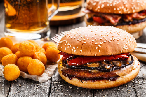 Fotografia, Obraz  Delicious burger with fried potato balls and beer