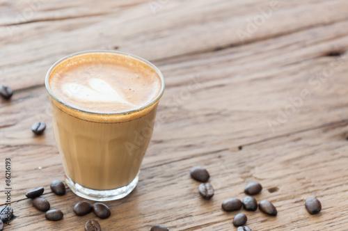 Fotografie, Obraz  Hot cafe latte on wood table