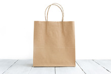 Paper Bag On The Wooden Backgr...