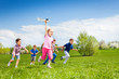 canvas print picture View of girl with airplane toy and following kids