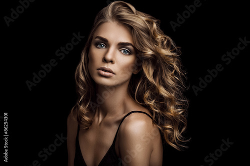 Vogue style close-up portrait of beautiful woman with long curly