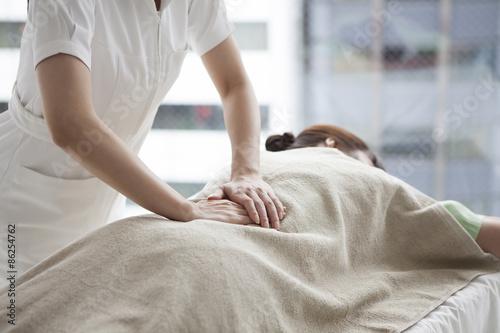 Women who have a waist a massage Fotobehang