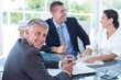 Smiling business people brainstorming together