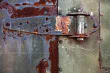 Old Rusty Metal Hinge On The Metal Door