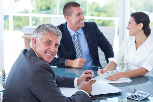 Fototapety, obrazy: Smiling business people brainstorming together
