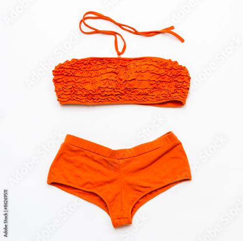 Obraz Orange bikini swimsuit  on white background. - fototapety do salonu