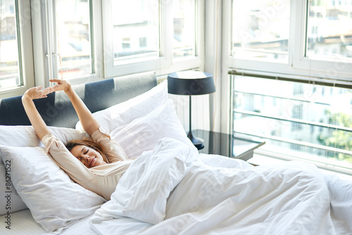 Obraz Woman sitting in bed - fototapety do salonu