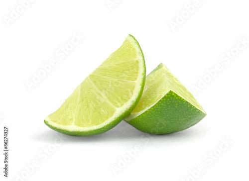 Obraz na plátne fresh lime wedge isolated on a white background