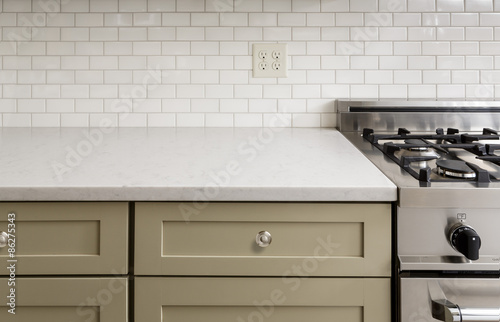 Fotografía  Kitchen Counter with Subway Tile, Stainless Steel oven stove, Sh