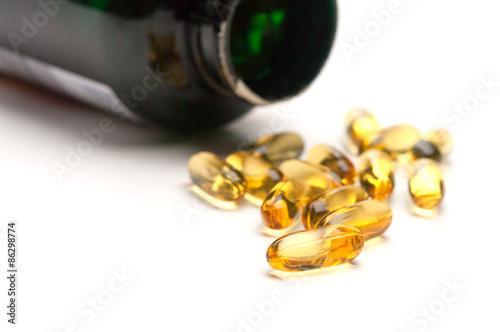 Fotografie, Obraz  Spilled bottle of Fish Oil Capsules
