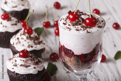 In de dag Dessert Dessert cherry black forest and cupcakes close-up. Horizontal