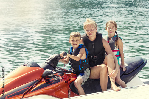 Spoed Foto op Canvas Water Motor sporten Group of People enjoying a ride on a personal watercraft on a warm summer day on the lake