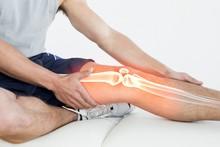 Highlighted Knee Of Injured Man