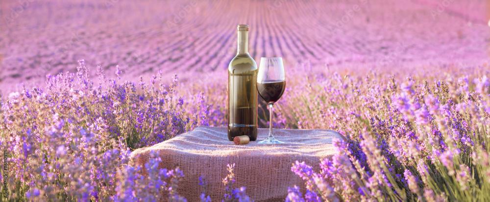 Fototapety, obrazy: Bottle of wine against lavender.