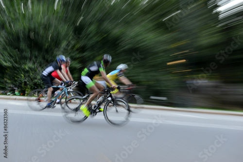 Foto op Plexiglas Fietsen Blurred motion of Cyclists riding on bicycles at speed