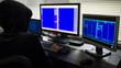 Hacker in hood stealing information
