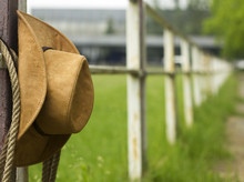 Cowboy Hat And Lasso On Fence American Ranch