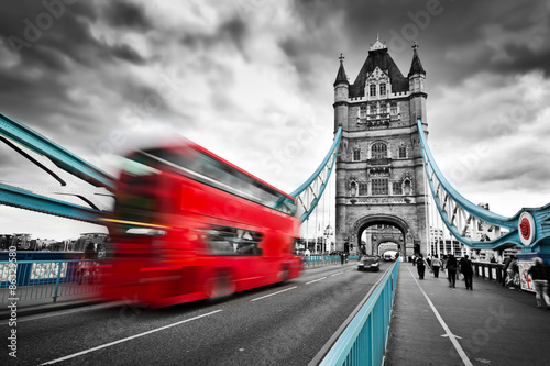 Fényképezés  Red bus in motion on Tower Bridge in London, the UK