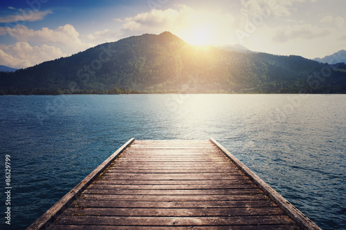 Fotografiet  landscape with lake, moorage and hills